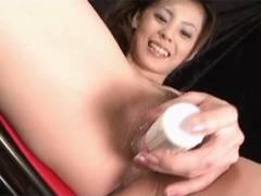 Sexy Natsumi pokes a vibrator around her toolbox